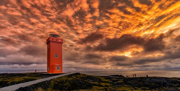 Golden sky over lighthouse
